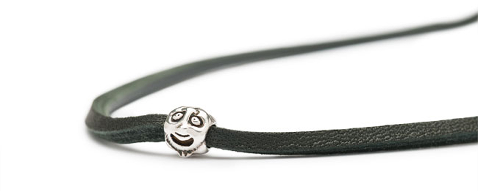 Faces silver bead on black leather bracelet